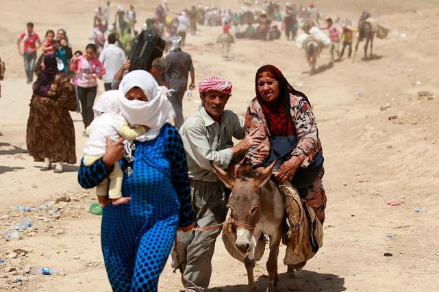 1065585-syriens-fuient-leur-pays-traversent